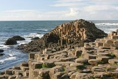 The Giant's Causeway in Northern Ireland consists of more than 40,000 interlocking volcanic rock pillars, most of which are hexagonal, although some have fewer or more sides. Legend has it that the giant Finn McCool fashioned the Giant's Causeway to walk across the sea to Scotland and face his great rival Benandonner. Researchers say it was created by lava traveling out of cracks in the earth 60 million years ago, which cooled over time into a honeycomb pattern, with some pillars standing as…
