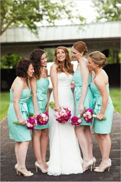 teal bridesmaid dresses and bright flowers http://www.weddingchicks.com/2014/01/02/horse-racing-wedding/
