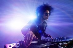 Photo about Club DJ with afro hairstyle playing mixing music on vinyl turntable at party wearing sunglasses with lens flare from nightlife lights. Reggae Style, Reggae Music, Folk Music, Music Mix, Studio 54 Disco, Rihanna Work, Dj Images, Reggae Festival, Wedding Dj
