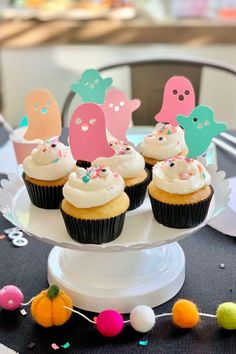 Get spooked by this colorful Halloween party! The table settings are amazing! See more party ideas and share yours at CatchMyParty.com#catchmyparty #partyideas #halloween #halloweencupcakes #halloweenparty #kidshalloweenparty Halloween Party Favors, Halloween Cupcakes, Halloween Kids, Halloween Treats, Ghost Cupcakes, Mini Cupcakes, Fancy Sprinkles, Cupcake Flavors, Beautiful Cupcakes