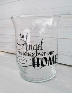 """An Angel Watches Over Our Home.  Clear glass Candle Holder.  Decorative saying done in permanent vinyl.  4.5"""" tall by allwrappedupandmore on Etsy"""