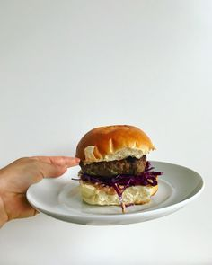 Ginger Pork Burgers // With ramps, ginger & mint in the pork patties, a quick side of red cabbage slaw, and a hoisin mayo this simple meal is packed with flavors. // The Leek & The Carrot blog