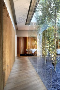 There is such a beautiful classic Japanese feel to this space with very clean lines, wood / bamboo varieties, floor to ceiling glass windows. I love how the timber flooring is laid in a diagonal pattern.