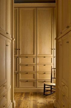 Large Closet chic walk in closet features a large closet island fitted with