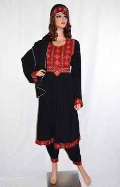 """Nazirah Black Kuchi Dress.  Beautifully embroidered traditional Afghan Kuchi tribal dress in black. The material is soft, breathable, and light weight, perfect for the summer! Comes with matching pants, head scarf, and adjustable belt at the waist. The measurement of the bust is 22"""" from seam to seam, and the length is 40"""" long from the back. Size: Small to Large (Depending on bust size) http://www.zarinas.com/dresses2.shtml"""