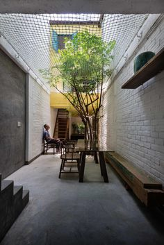 A city home honors the local culture with communal outdoor space and reclaimed materials. @Saigon