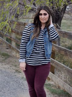 black and white striped shirt and maroon skinnies outfit with denim vest