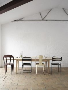 dining-rooms-black-light-wood-white-dining-chairs-dining-tables-vaulted-ceilings