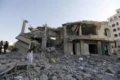 Saudi strikes on Yemen civilians may be crimes against humanity: U.N.  -   A Houthi militant stands guard outside the house of court judge Yahya Rubaid after a Saudi-led air strike destroyed it, killing him, his wife and five other family members, in Yemen's capital Sanaa January 25, 2016. REUTERS/Khaled Abdullah