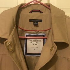 Tommy Hilfiger jacket Light jacket, perfect for spring or fall weather. Comes to the midthigh area when on. Cotton and polyester outer shell, polyester lining on inside. Snaps to close, looks like brand new. Great condition. Tommy Hilfiger Jackets & Coats