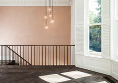 Contemporary walnut balustrade with darkened metal spindles. Walnut flooring laid in a herringbone pattern, with panel beading and plantation shutters. Metal Spindles, Architects London, Walnut Floors, Residential Architect, Herringbone Pattern, Bay Window, Shutters, Paint Colors, Terrace