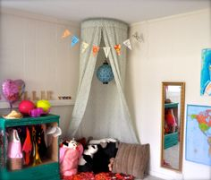easiest DIY canopy ever! I really need to make the girls a reading nook.