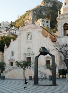 Taormina, Sicily, Italy  I'VE BEEN IN THIS EXACT SQUARE AND SAW THAT EXACT CHURCH. i want to go back here. so bad.