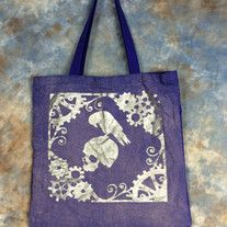 Perfect gift for any Steampunk or E. A. Poe fan!  Bleach Dyed & Hand painted Steampunk Raven & Skull bag. Design is painted in metallic silver & bleach dyed on ONE side of the bag. Perfect for conventions, trips to the comic shop, as a reusable shopping bag or as a purse.  Blueberry (Blueish ...