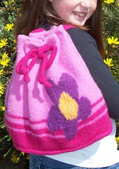 Free Knitting Pattern for Ayla Backpack - Felted striped backpack with flower motif. Size after felting is 13 inches high and 10 inches wide. Designed by Jordana Paige