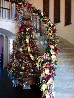 Burgundy and gold Christmas tree and decorated staircase