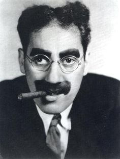 """Groucho Marx (1890 - 1977) Leader of the Marx Brothers, appeared in the movies """"Animal Crackers"""", """"Duck Soup"""" and """"A Day at the Races"""", was the host of the TV game show """"You Bet Your Life"""""""