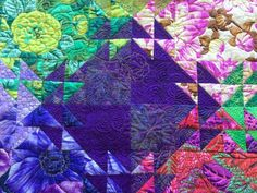 Shimmering Triangles Quilt is 4 patch, star blocks & whole blocks put together to make the quilt shimmer