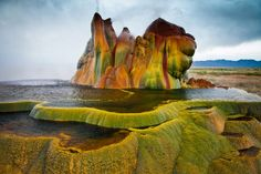Fly Geyser, United States, located in the Nevada Desert, is a collection of three large, colorful mounds which continually shoot five feet of water straight up into the air. It was accidentally created in 1916, during a routine well-drilling. It worked normally until the 1960s, when heated geothermal water started spurting out through the well. Dissolved minerals began to accumulate and gradually built up into the large, colored mounds we see today. Fly Geyser is located on private property.