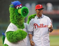 Sixers G-F Evan Turner poses with the Phanatic.
