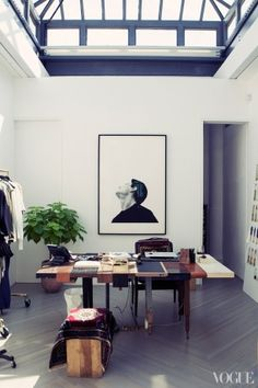 """Lim's office has a giant greenhouse skylight, and the subject of his Robert Longo print, Study for Relief-Z Head, looks like he is gazing into the open sky. """"I love how he's always dreaming,"""" Lim says."""