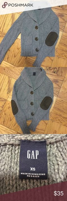 Gap sweater cardigan with elbow patches Gap warm cozy cardigan sweater. Very versatile. Lambs wool blend. Gray speckled with big brown buttons. Two small pockets in front. Brown elbow patches GAP Sweaters Cardigans