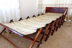 Concertina canvas bed pulls out from bench seat. Awesome!