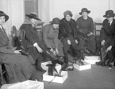 Women in World War 1 - Women police appointed for duty at a munitions works trying on new boots. United Kingdom, 30th January 1917.