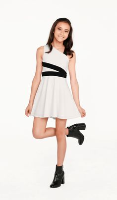 The Blaire Dress Ivory stretch crepe knit fully lined fit and flare dress with black trim detail Tween Event & Party Dresses Tween Fashion, Girls Fashion Clothes, Girl Fashion, Tween Girls Clothing, Girls Dresses Tween, Dresses For Tweens, Cute Teen Outfits, Kids Outfits Girls, Cotillion Dresses