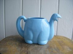 Adorable ceramic powder blue dinosaur pitcher. Label on bottom reads MOGI NAGOYA SAMPLE JAPAN  1980's