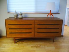 mid-century modern dresser... great idea for mini bar and/or record player  (in dining room, den or man cave)