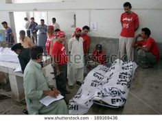 KARACHI, PAKISTAN - APR 25: Dead bodies of victims who killed in blast at Chaudhry  Khaliq-uz-Zaman road of Gizri DHA Phase 4 are being kept at Jinnah Hospital Mortuary on April 25, 2014 in Karachi. - stock photo
