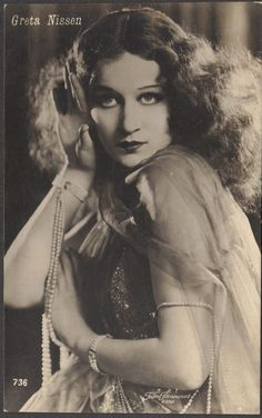Greta Nissen, Silent Film Star, wears matching pearl slave bracelets, circa 1920s, by redpoulaine