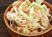 Carolina Slaw...made without carrots and onion. Recipe makes way too much liquid and seemed to use too much oil. Had to drain off some liquid. Was tasty though!