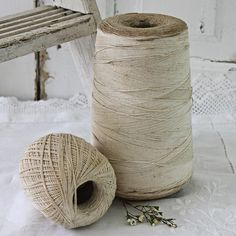 thread spools ans weathered white bench