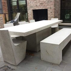 Kara Mann Installation in Chicago. Slab Table and 5 Stone Dining Chairs with a Custom Aspen Bench. Modern Outdoor Living, Modern Outdoor Furniture, Modern Patio, Outdoor Seating, Outdoor Chairs, Dining Chairs, Outdoor Patios, Backyard Patio, Backyard Ideas
