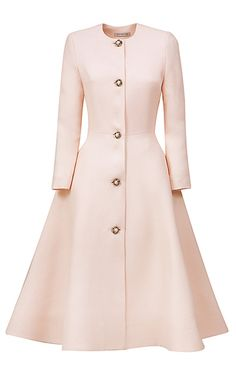This **Esme Vie** coat features a round neckline, long sleeves, front flower pearl button placket, trapeze line silhouette, and a below the knee hemline.