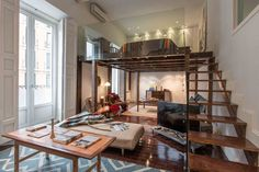 Unique Artistic Loft Apartment In Madrid, Spain | The 1,800 sq. ft. loft has three bedrooms, a sleeping loft above the living room, two bathrooms and is available for holiday rental via The Sibarist. | visit idesignarch.com for additional beautiful photos, as well as other sources of inspiration.