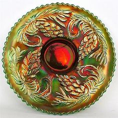 I love carnival glass bowls. I have a pink one and I love how pretty and happy they look.