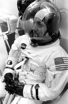 """""""Jack Swigert suited for launch with an Omega Speedmaster velcro strapped to his left wrist. This is probably the Speedmaster which timed the mid-course burn so critical to the return of Apollo 13. (1970)"""""""