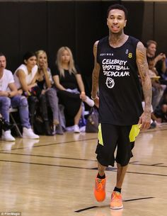 Tat's my guy: Kylie watched proudly as Tyga shot some hoops. The rapper's tattoos were wel...