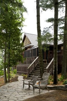 Kenny G's Rustic Retreat.  This custom getaway, built on a rugged patch of land on Lake Joseph, has raw yet refined style.