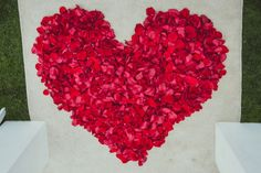 Heart-shaped backdrop for ceremony made out of rose petals