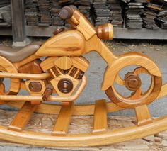 Handcrafted; One of a kind motorcycle rocker very detailed . Because each cycle rocker is handcrafted and many accessories are hand carved no two motorcycle rockers are alike. All rockers are made to order. The motorcycle pictured is handcrafted of Black walnut Oak, Cedar; Motorcycle rocker have anti-roll ends so rocker will not tip over during play time. dimension of rocker is 56 long 24 wide dimension of cycle body is 37 long 26 total height. with leather upholstery saddle. Motorcycle…