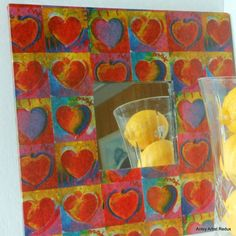 Wall mirror with Peter Max Art paper decoupage.