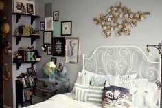 beautiful bookshelf nook and cat pillow