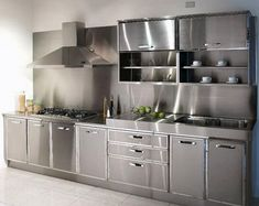 Either the price is one of the things you have to keep in mind, or not, there are enough IKEA kitchen design ideas here to inspire you into getting exactly what you want for your new or remodeled kitchen. We have found interesting takes on how you can redesign your kitchen with IKEA furniture and details, and how you can get them personalized for you to get a kitchen that feels more yours than something out of a catalog. Go ahead and take a look at the outstanding ideas we put together for you. Aluminum Kitchen Cabinets, Stainless Steel Kitchen Cabinets, Aluminium Kitchen, Outdoor Kitchen Cabinets, Kitchen Units, Kitchen Cupboards, Kitchen Furniture, Kitchen Ideas, Cozy Kitchen