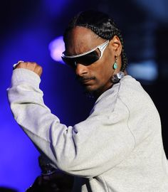 Snoop Dogg wearing Parasite Pross sunglasses during a show
