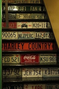 Basement Stairs Remodel: man cave- Stair treads are painted black & the risers are covered with license plates & some other signs. The stairs then become a kind of display case for the license plate collection. Refinish Stairs, Wallpaper Stencil, Wallpaper Ideas, License Plate Art, Basement Stairs, Garage Stairs, Tile Stairs, Glass Stairs, Attic Stairs