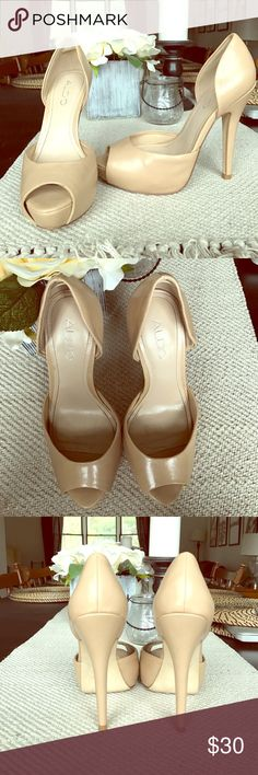 Aldo nude pumps Only worn a couple of times before I realized they were too small for me. Tan or nude leather peep toe pumps from Aldo , great condition a little scuff on the bottom ( just from walking) but completely unnoticeable. Aldo Shoes Heels